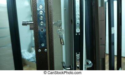 steel door in the store range of purchase sale with keys -...
