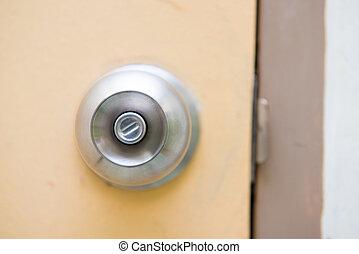steel door knob on the yellow door
