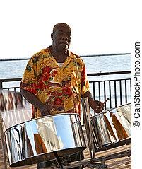Steel Drummer - A caribbean musician playing steel drums.