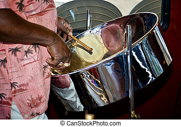 Steel Drummer - close up of man playing a steel drum