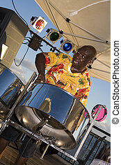 Steel Drummer Jamming - A Caribbean musician jamming on his...
