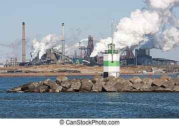 Steel factory with harbor at the Dutch coast - Big steel...