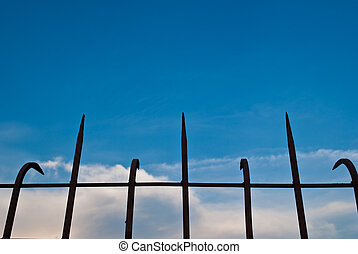 Steel fence with the blue sky.