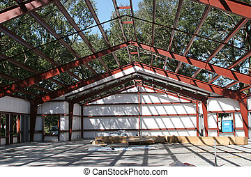 A steel framed building under construction. Large depth of field with focus on roof beams.