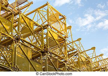 Steel frame of old cranes - Stacked steel frames of old...