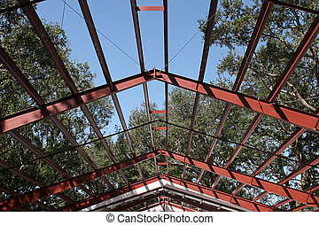 The steel beams of a roof in a newly constructed steel home.