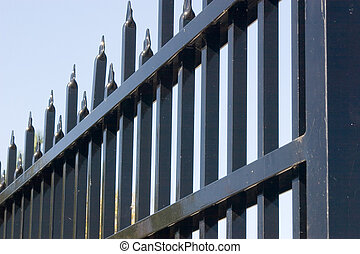 Steel gate - A steel gate making a striking pattern against...
