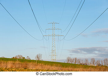 Steel high voltage poles and electric wire with blue sky and...