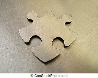 Steel jigsaw alone on a metallic background