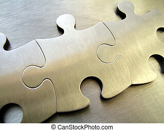 Steel jigsaw - Three jigsaw close-up