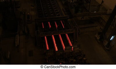 Steel mill plant. Metal tube production line at metal...