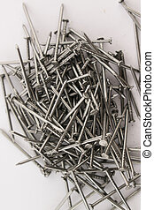 Steel nails on white background