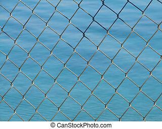 net - steel net  with blue sea in background