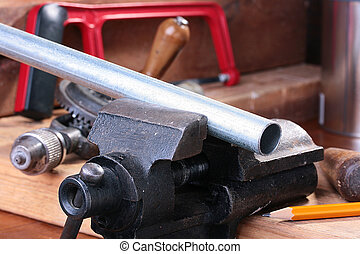 Steel pipe - The steel pipe is fixed in a joiner\'s vice for...