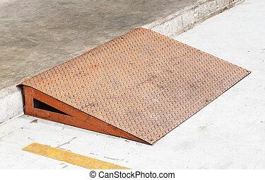 Steel plate ramp - Grunge diamond steel plate ramp in car ...
