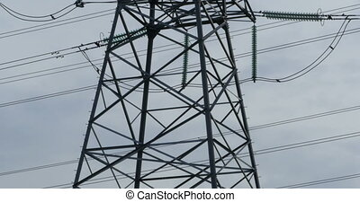 steel pole of high voltage transmission line, panorama down...