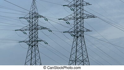 steel pylon of high voltage transmission line, panorama down...