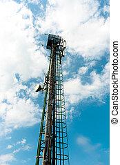 Steel radio tower against blue sky