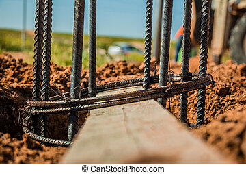 Steel rod used for poles construction with reinforce concrete in a hole in the ground at construction site