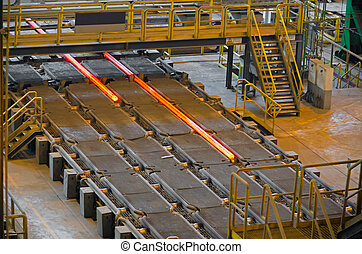 Photograph shows the process of making steel billets for pipes.