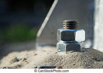 Steel silver bolt fasten iron post, industrial background.