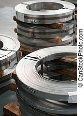 Steel supply - Rolls of hopp iron in a metal workshop