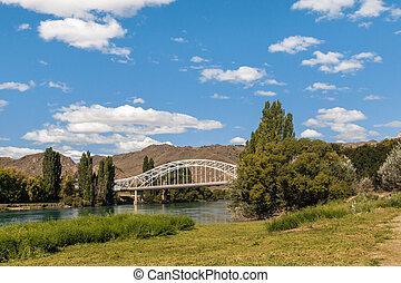 steel truss arch bridge above Clutha River in Alexandra, Central Otago, South Island, New Zealand