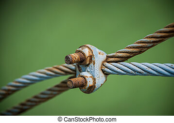 Steel turnbuckle and steel sling anchored safety net into ...