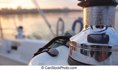 Steel winch without rope on sailing boat. Dynamic change of focus. Close up