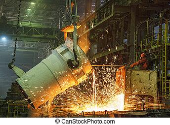 steel worker takes a sample of hot metal