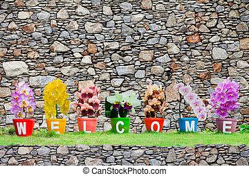 steen, gemaakt, woord, muur, welkom, vrijstaand, jardiniere, achtergrond, bloemen, orchidee