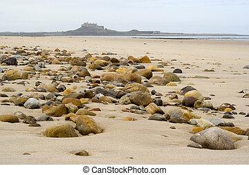 steentjes, eiland, zand, heilig