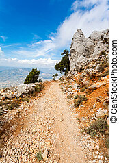steep dangerous mountain road with a big gravel in the mountains of Sardinia, Italy