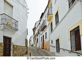 Steep narrow street in the ancient Ronda