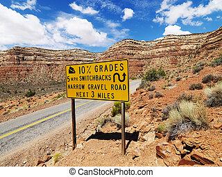 Steep road warning sign.