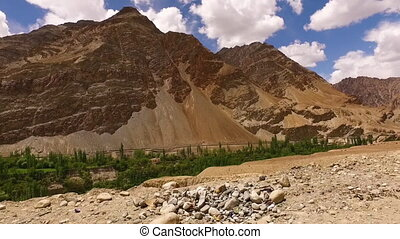 Steep, rocky mountains jutting up from a desert - Steep,...