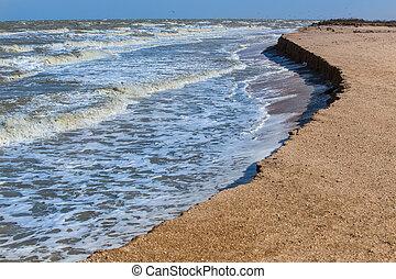 Steep sea bank. Huge waves.