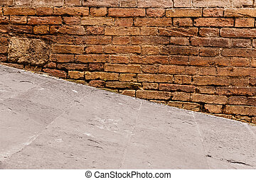 Steep walkway with old wall in Italy, Europe