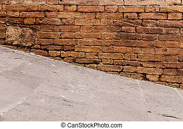Steep walkway and old wall - Steep walkway with old wall in...