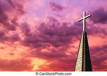 Steeple Cross at Sunset - Colorful sunset sky backs a...