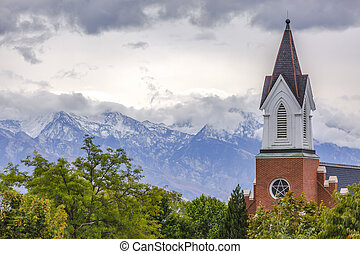 Steeple of church with mountain in the background