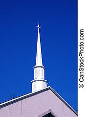steeple - shite steeple against a bright blue sky