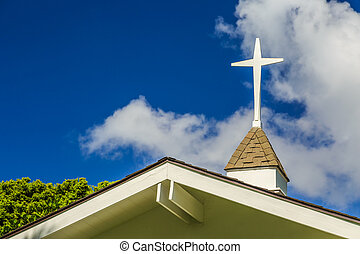 Steeple - The steeple and cross on the roof of a small...