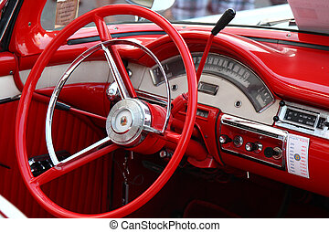 steering wheel and dashboard interior of vintage classic car