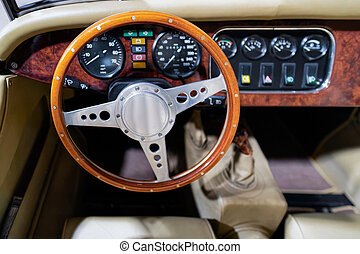 Steering wheel and speedometer of vintage classic car in Berlin in Germany. Details of auto