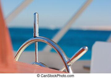 Steering wheel on a motor yacht