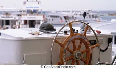 Steering Wheel on a Ship Floating in the Sea