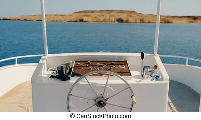 steering wheel on a yacht. - Metal steering wheel and...