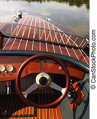 Steering wheel on boat. - Wooden boat with steering wheel...