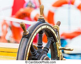 Steering wheel on sailing ship